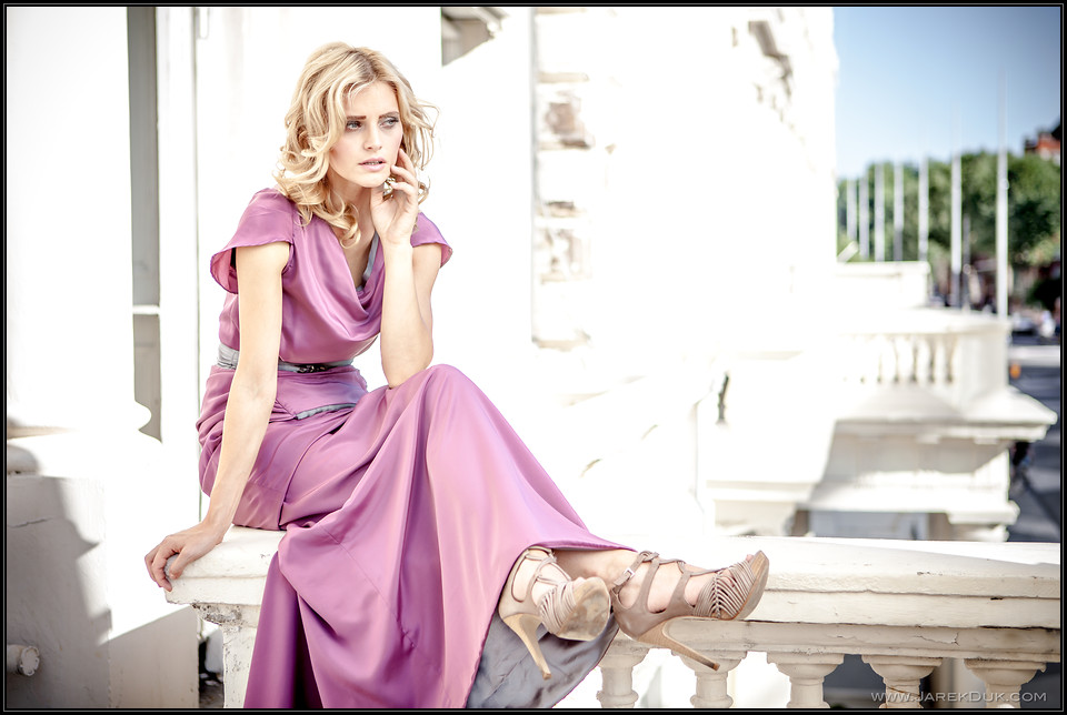 Outdoor fashion photography London. Blond girl in pink evening dress. Fashion photographer London Jarek Duk.