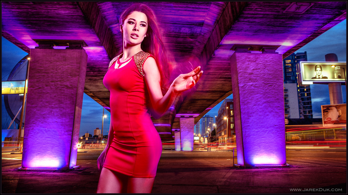 Fashion photography London, dramatic and dynamic picture of woman in a red dress, night scene.
