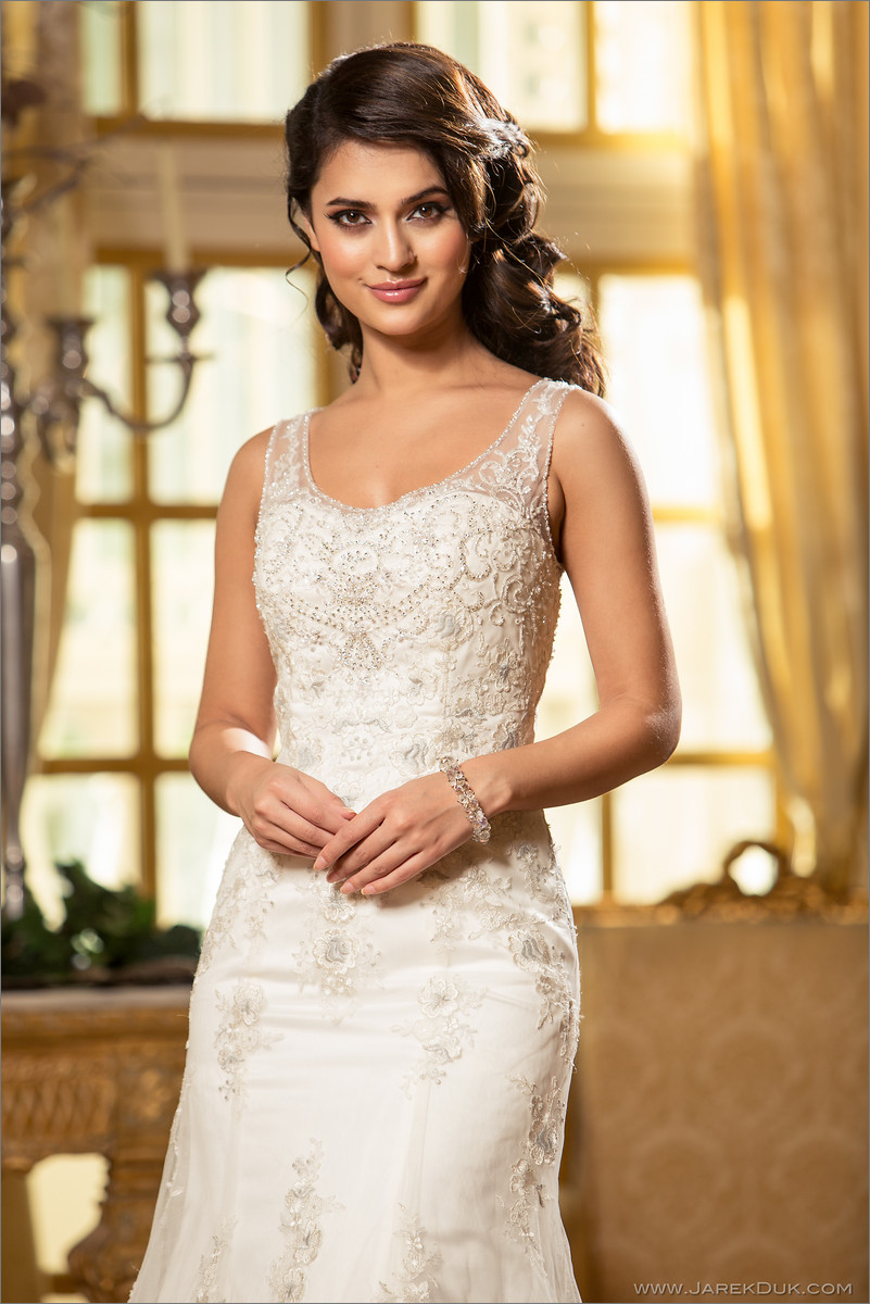 Bridal fashion photographer London. Beautiful bride in a white, romantic wedding dress in luxurious palace setting.