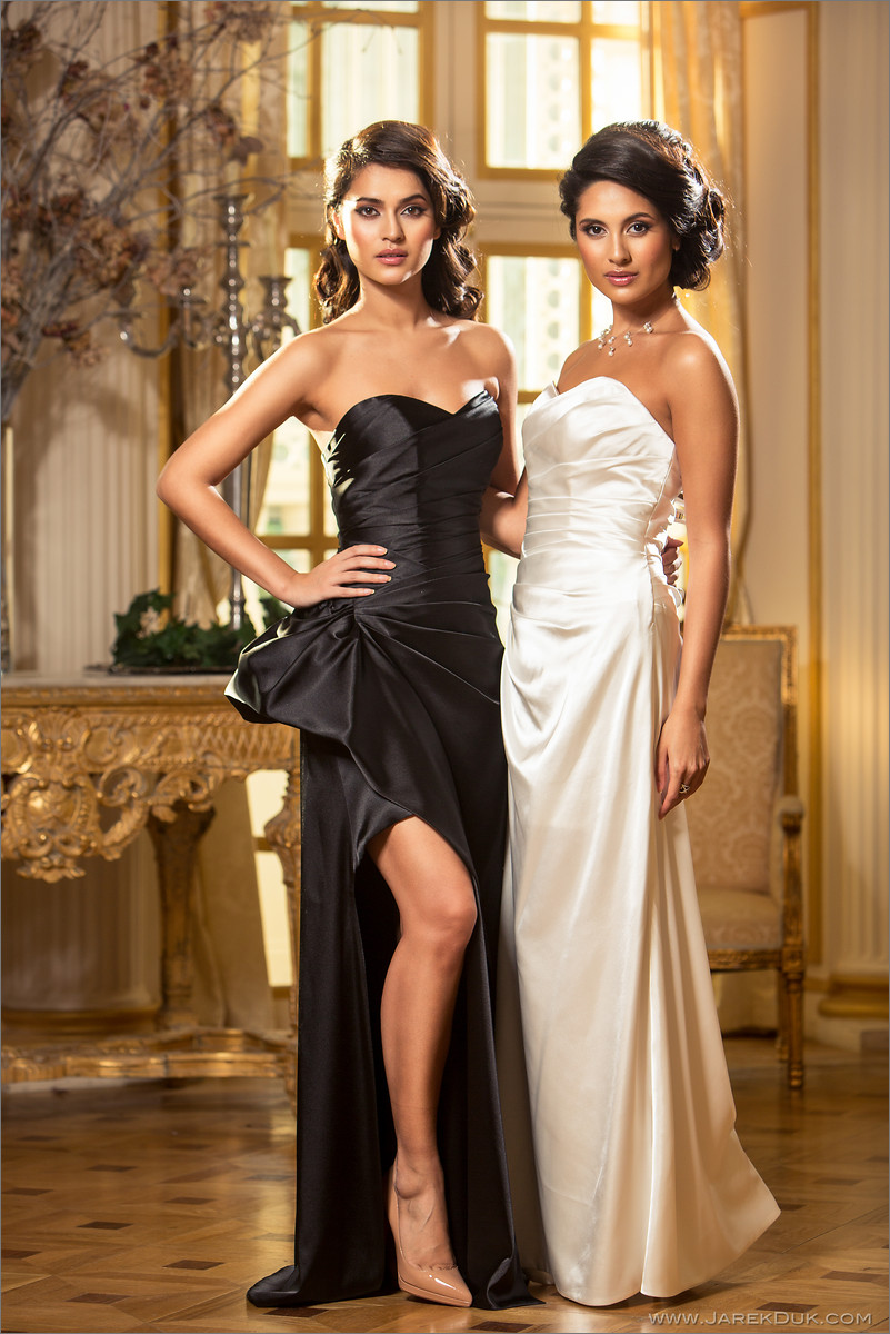 Bridal fashion photographer London. Beautiful bride in a white wedding dress and bridesmaid in luxurious palace interior.