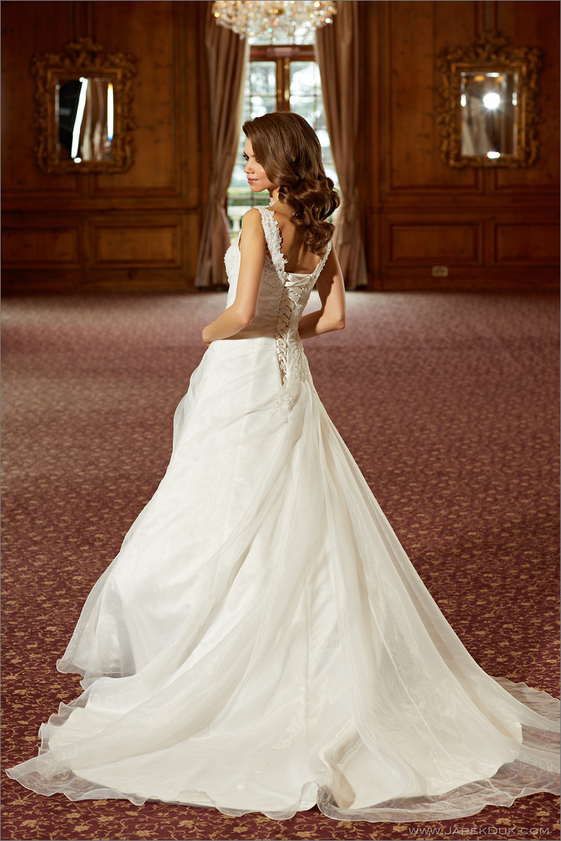 Bridal fashion photographer London. Beautiful bride in a white, romantic wedding dress in a ballroom.