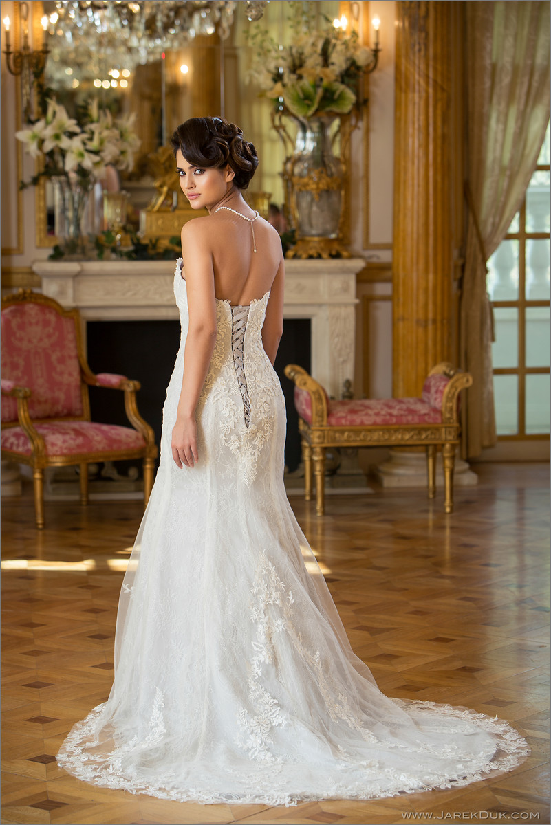 Bridal fashion photography London. Bride in a white, romantic wedding dress in posh location.