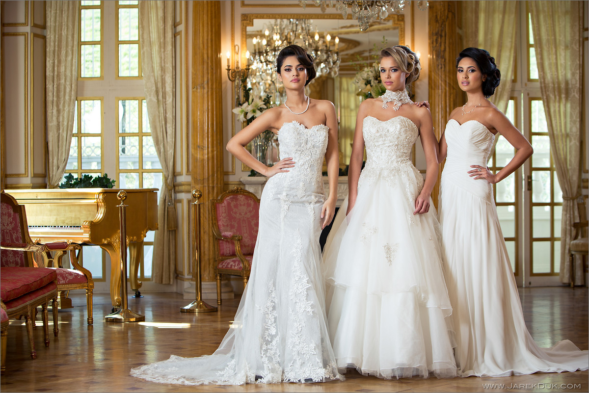Bridal fashion photography London. Three brides in a white wedding dresses in a palace luxurious interior.